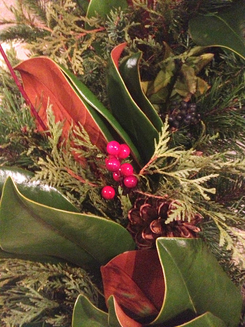 magnolia leaves, berries, pine cone wreath
