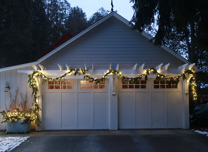 Garage pergola lit up for the holidays