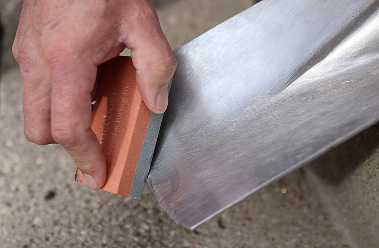 Sharpen the blade using a whetstone