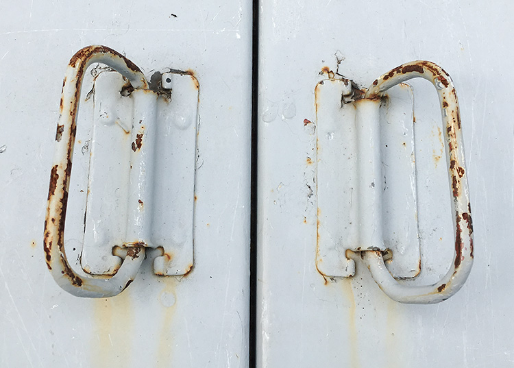 Rusty cellar door handles