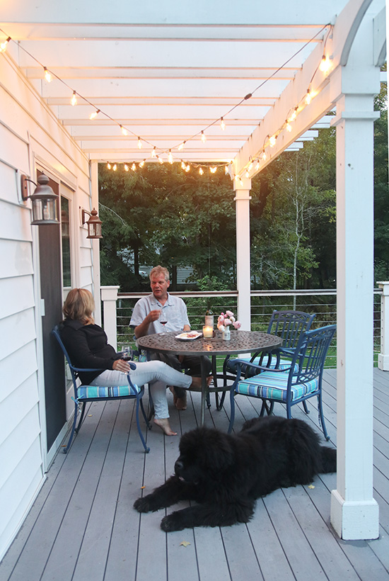 Cafe lights add warmth to any outdoor seating area.