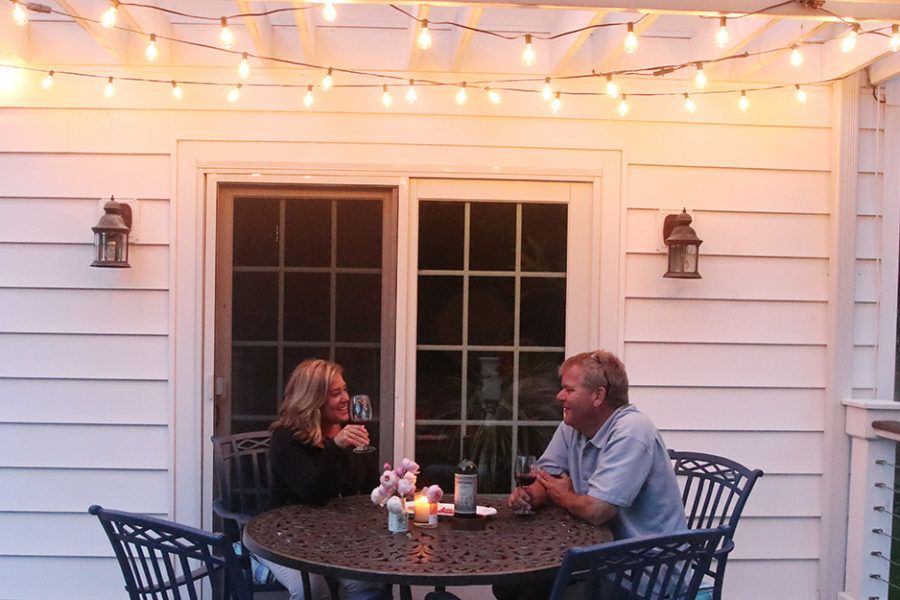Cafe lights offer warmth to outdoor seating areas.
