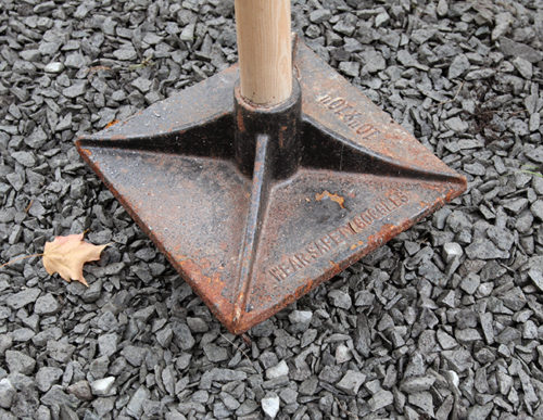 Tamp down crushed stone to create a firm base.