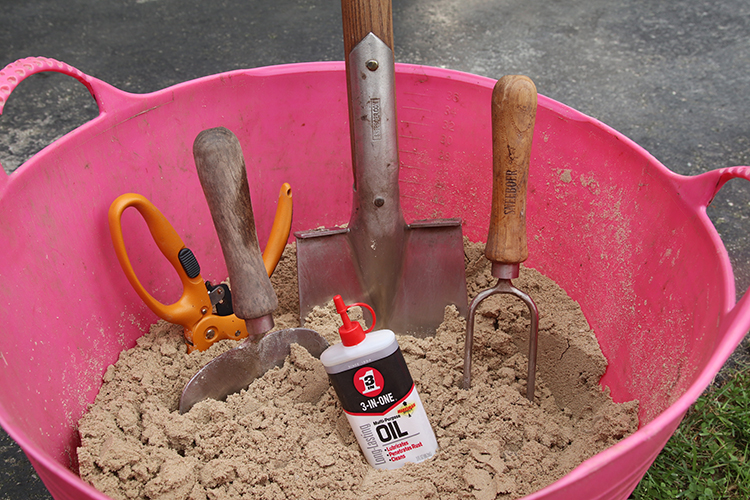 Add a little 3-in-ONE Multipurpose oil to clean sand to store and protect  your garden tools.