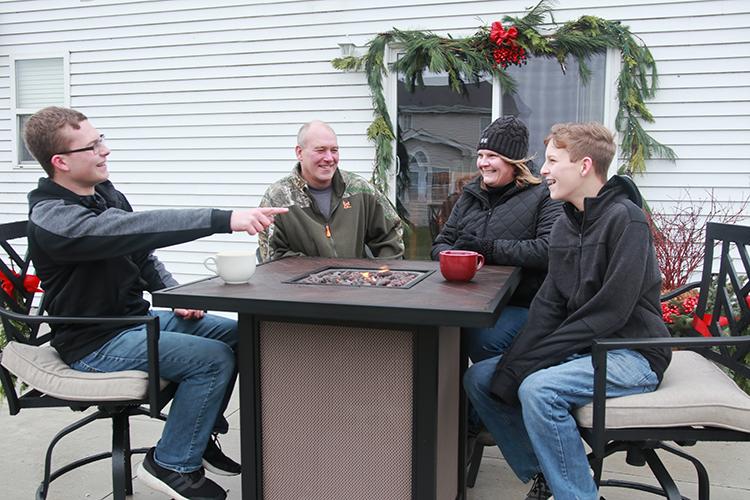 Family enjoys fire table